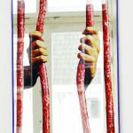 MAURIZIO CATTALAN, Sausage Mirror, n.d. [2014]
